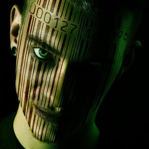 Close up of mans face with a full length barcode scanned on to it.