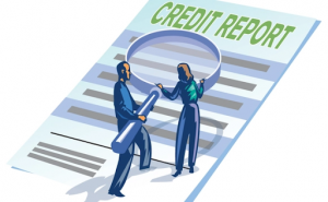 A man and a woman with a magnifying glass looking over a credit report.