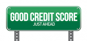 Green road sign with Good Credit Score Just Ahead written on it with large white letters.